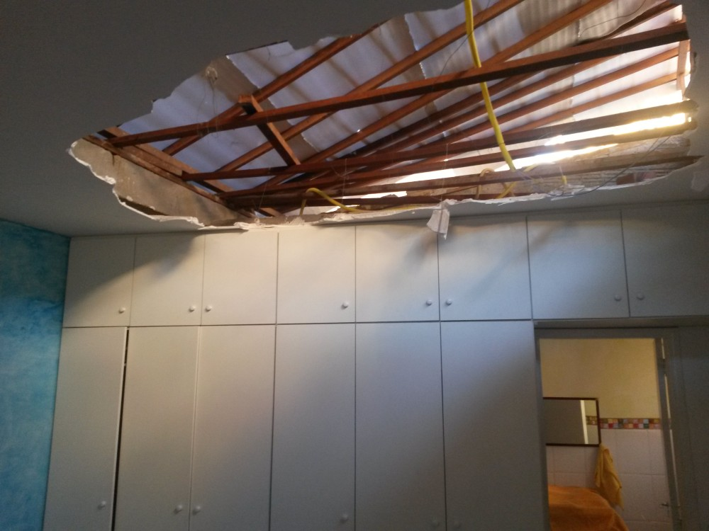 JS reparo de teto e telhado